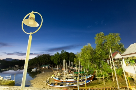 long exposure of fisherman boats in canal twilight time, phuket Thailand Stock Photo - 16378408