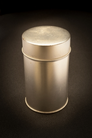 old aluminum can isolated on black photo