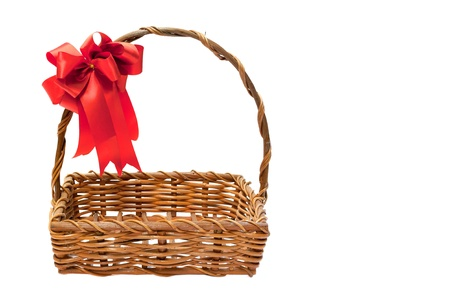 Bamboo basket isolated on white background Decorated with red ribbons on top Standard-Bild