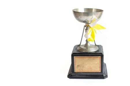 old trophy with white and yellow ribbons isolated on white background Stock Photo - 16378980