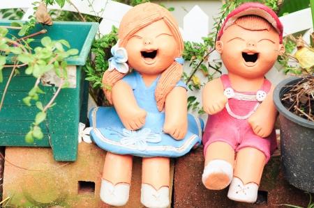 boy   girl ceramic doll garden photo
