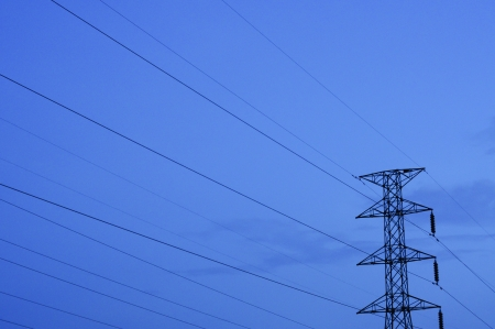 The high voltage electric post in night time photo