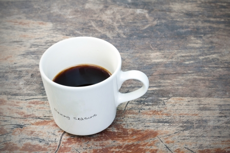 mug of coffee: Hot Cup of Coffee on a grungy Wooden Table