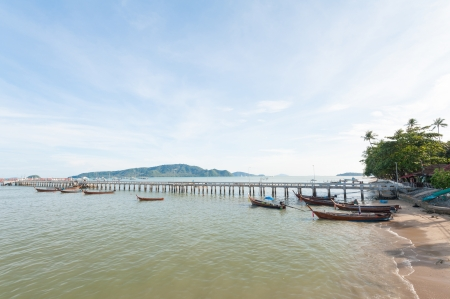 fisherman boats resting near bridge in Andaman sea, Phuket Thailand Stock Photo - 17137538
