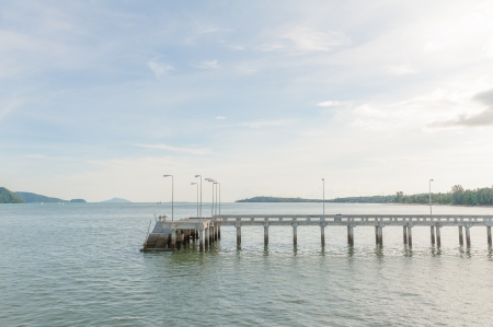 Concrete walk bridge across the sea with the cloudy sky at chalong pier, phuket Thailand Stock Photo - 16739417