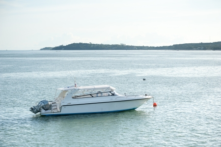 Single boat floating on a andaman sea surface photo