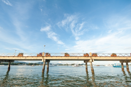 Concrete walk bridge across the sea with the cloudy sky at chalong pier, phuket Thailand Stock Photo - 16733266