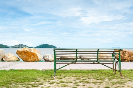 green Bench looking out to the sea on coast of phuket island, Thailand Stock Photo - 16739975