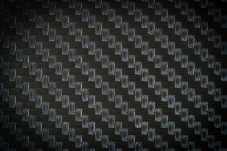 close up photograph of carbon fiber texture background photo