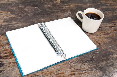 Open blank note book with coffee cup on grunge wood photo