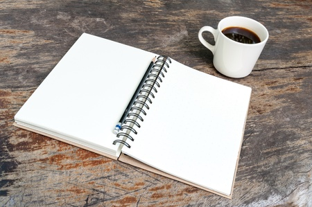 Open blank note book with coffee cup on grunge wood Stock Photo - 16951244