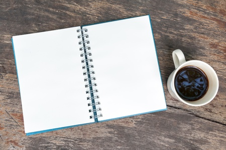 Open blank note book with coffee cup on grunge wood Stock Photo - 16889168