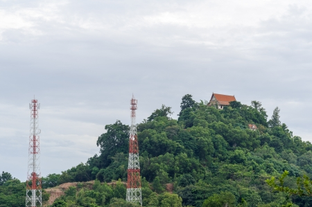 Telecommunications antennas tower in mountain photo