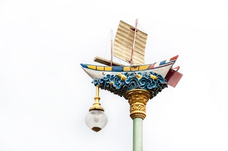 aglow: antique boat lamp pole on white background