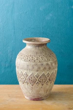 antique ceramic vase green wall background Stock Photo - 17174441