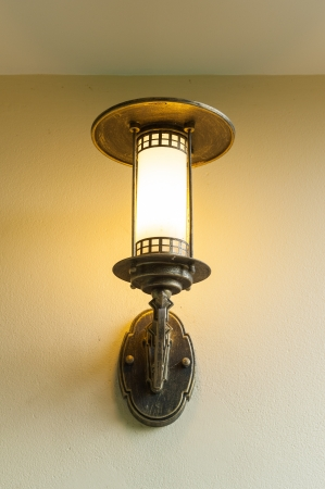 antique wall lamp on creamy wall Stock Photo - 17174396