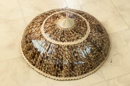 conical hat: Asian conical straw hats traditionally style on floor