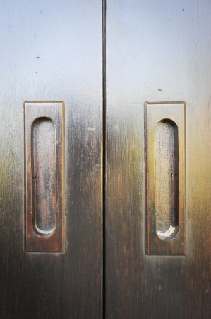 wooden flush handle on wooden door photo