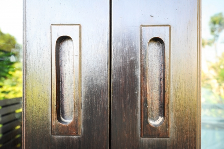 wooden flush handle on wooden door photo