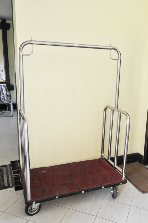 hotel baggage cart in corner photo