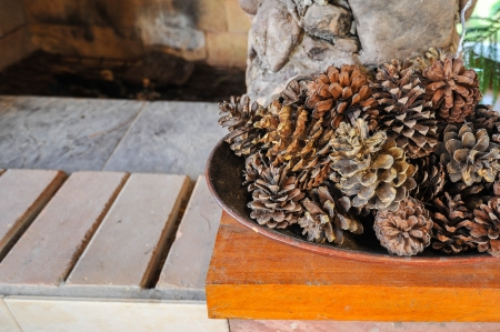 pine cone in wooden tray for decoration photo