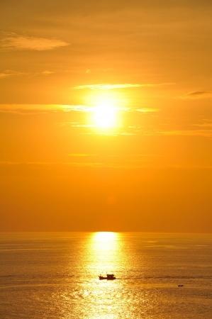Fisherman s boat silhouette at sunset, Andaman sea phuket Thailand Stock Photo