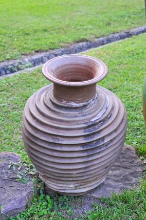 Earthenware Vase ancient in garden Stock Photo - 17595121