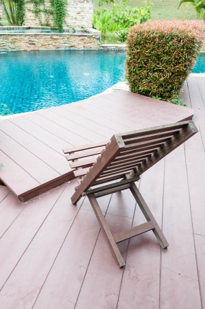 wooden chair beside swimming pool Stock Photo - 17726613