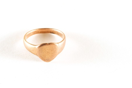 copper alloy ring heart shape on white photo