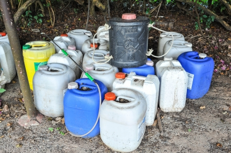plastic container of insecticide for farmer Standard-Bild