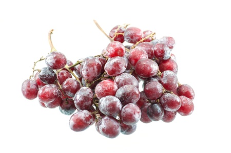 Fresh purple grape fruit on white background photo