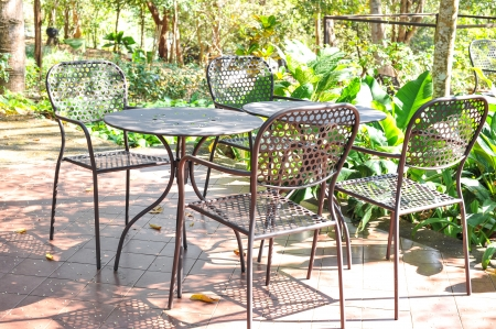 Metal chairs and table in garden deck photo
