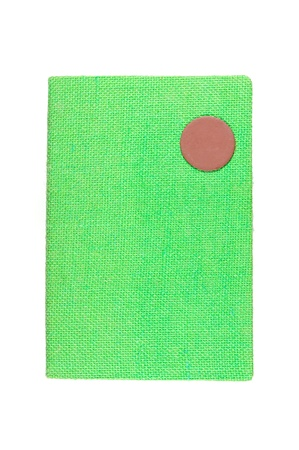green fabric cover note book on white background photo