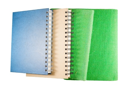 Stack of various note book on white background photo