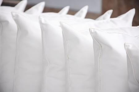 white pillows leather on cushion Stock Photo - 17945386