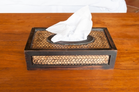 Tissue paper box made by basketry bamboo on wooden table photo