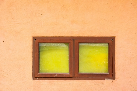 colorful window on orange wall at thailand photo