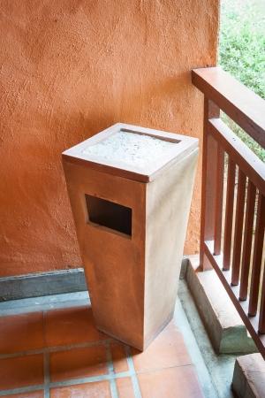 cement bin and ashtray in hotel corridor photo