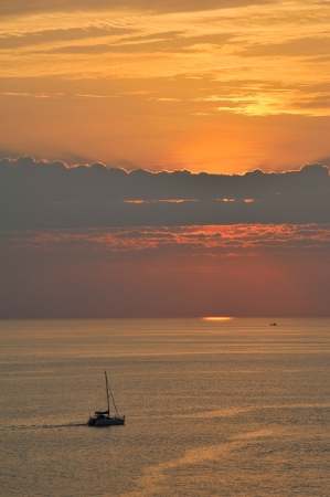 sailing boat silhouette at sunset, Andaman sea phuket Thailand photo