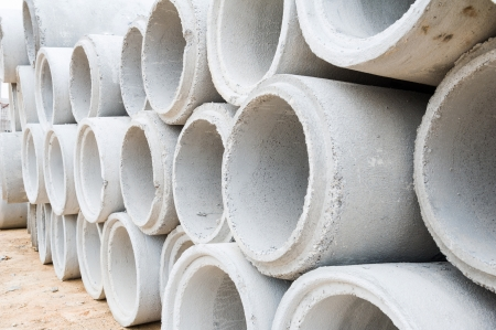 Concrete drainage pipes stacked on construction site Stock Photo - 18173644