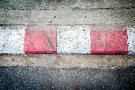 Texture of motor race asphalt and red white curb Stock Photo