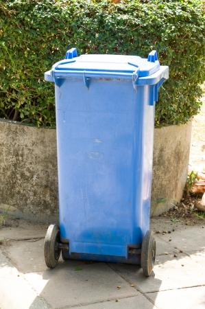 blue plastic bin in park photo