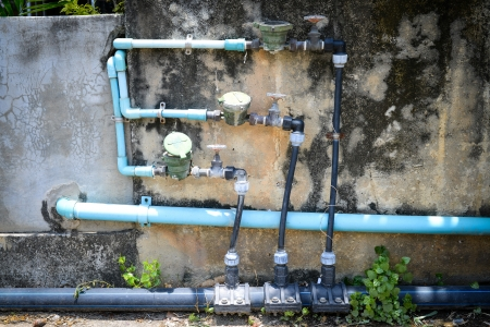 water pipe and meter with old wall  photo