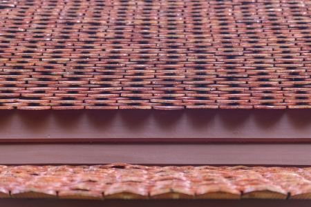 Ancient thai style roof made from clay tiles with shallow DOF   photo