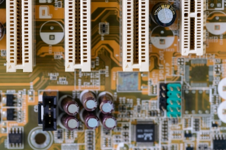 Detail of a dusty computer mainboard  photo