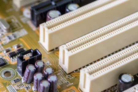 pci card: Closeup of dusty computer motherboard with details