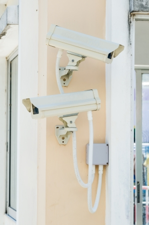 Security camera on wall of guard house