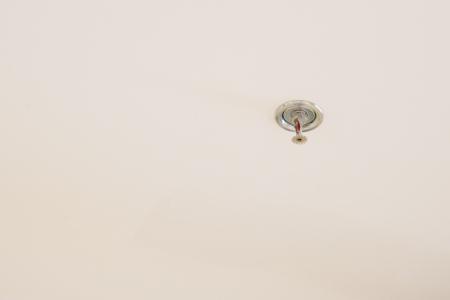 extinguishing: fire extinguishing sprinkler on ceiling  Stock Photo