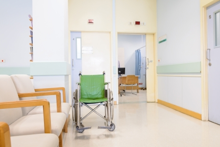 Wheel chair in front of examination room  Stock Photo