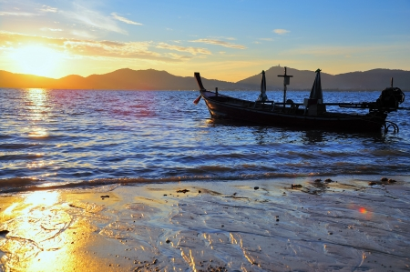 Fisherman s boat silhouette at sunset, Andaman sea phuket Thailand photo
